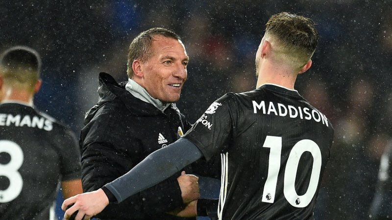 Leicester City's Northern Irish manager Brendan Rodgers reacts with Leicester City's English midfielder James Maddison / RESTRICTED TO EDITORIAL USE. No use with unauthorized audio, video, data, fixture lists, club/league logos or 'live' services. Online in-match use limited to 120 images. An additional 40 images may be used in extra time. No video emulation. Social media in-match use limited to 120 images. An additional 40 images may be used in extra time. No use in betting publications, games or single club/league/player publications. /