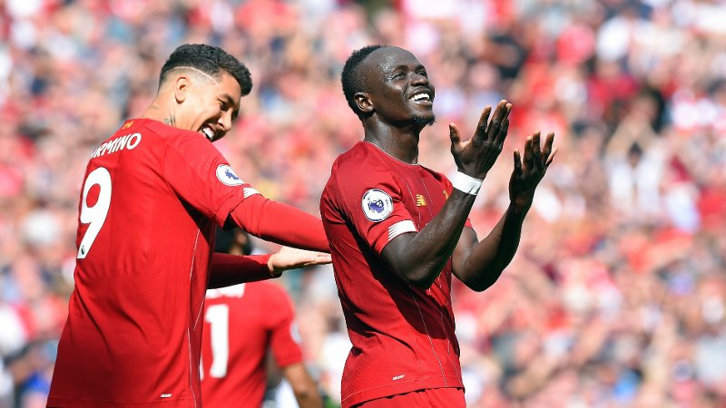Sadio Mane of Liverpool celebrates scoring his goal to make it 2-1 with team mate Roberto Firmino of Liverpool during the Premier League match at Anfield, Liverpool. Picture date: 14th September 2019. Picture credit should read: Robin Parker/Sportimage via PA Images