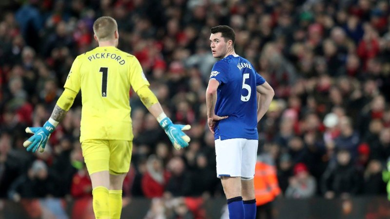 Everton's goalkeeper Jordan Pickford, left, and Everton's Michael Keane are seen after Liverpool scores the fifth goal against Everton during the English Premier League soccer match between Liverpool and Everton at Anfield Stadium, Liverpool, England, Wednesday, Dec. 4, 2019. Liverpool beat Everton 5-2.