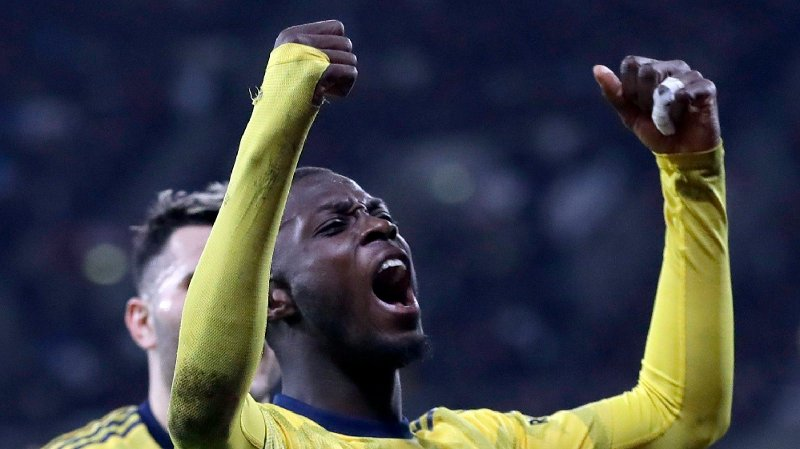 Arsenal's Nicolas Pepe celebrates after scoring his side's second goal during the English Premier League soccer match between West Ham Utd and Arsenal at the London Stadium in London, Monday, Dec. 9, 2019.