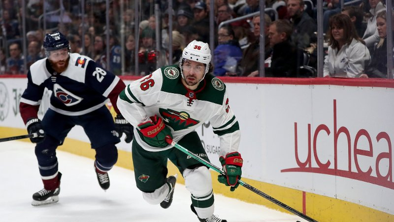 DENVER, COLORADO - DECEMBER 27: Mats Zuccarello #36 of the Minnesota Wild brings the puck off the boards against Ian Cole #28 of the Colorado Avalanche in the first period at the Pepsi Center on December 27, 2019 in Denver, Colorado. Matthew Stockman/Getty Images/AFP == FOR NEWSPAPERS, INTERNET, TELCOS & TELEVISION USE ONLY ==