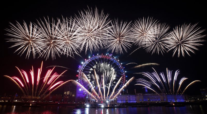 Britain New Year Fireworks explode over the London Eye Ferris wheel by the River Thames in London, to mark the start of the new year, Wednesday, Jan. 1, 2020.