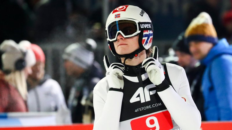 Marius Lindvik of Norway celebrates after his first round jump at the fourth stage of the 68th four hills ski jumping tournament in Bischofshofen, Austria, Monday, Jan. 6, 2020.
