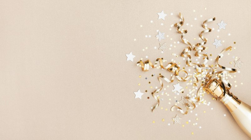 Celebration background with golden champagne bottle, confetti stars and party streamers. Christmas, birthday or wedding concept. Flat lay. Celebration background with golden champagne bottle, confetti stars and party streamers. Christmas, birthday or wedding concept. Flat lay style.