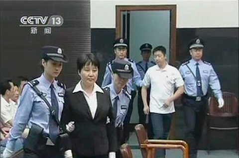 Gu Kailai (front, C), wife of ousted Chinese Communist Party Politburo member Bo Xilai, attends a trial in the court room at Hefei Intermediate People's Court in this still image taken from video August 20, 2012. A Chinese court sentenced Gu to death on Monday but suspended her execution, ending one chapter in a scandal that has shaken the ruling Communist Party ahead of a leadership transition later this year. The sentence means Gu is likely to face life in jail for murdering British businessman Neil Heywood last year, provided she does not commit offences in the next two years.