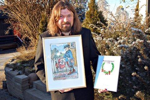 Henning Bergersen fra Ytre Enebakk, nå bosatt på Gol, med diplom og litografi laget av Drøbak-kunstneren Jan-Kåre Øyen i forbindelse med ØBs 100-årsjubileum.